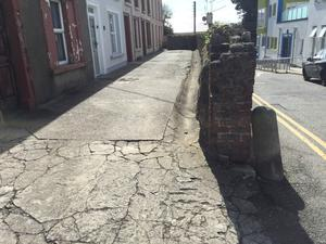 The broken and uneven path outside the houses at Clifford Terrace