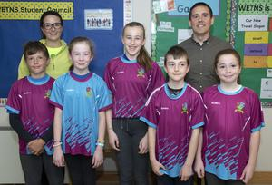 Teachers Thomas Forde and Aileen Kelly with Wexford Educate Together pupils in their new GAA jerseys