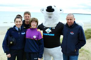 At the launch of the 2017 Special Olympics Polar Plunge in Rosslare (from left): Garda Anne Marie Doyle, Michael Nicholas (RNLI), Special Olympics athlete Shannon O'Farrell (Foulksmills), David McCusker/Polar Bear (RNLI) and Keith Morris (RNLI).