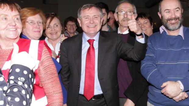 A thumbs-up from poll topper Brendan Howlin with supporters at the count centre.