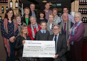 Liam Keating, Daffodil Day Collection organiser, and helpers, present the cheque for €16,545 to Carmel Murphy of the Irish Cancer Society