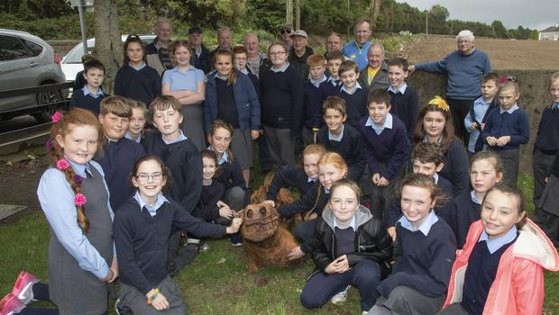 Pupils of Taghmon NS with the members of the local Men's Shed at the installation