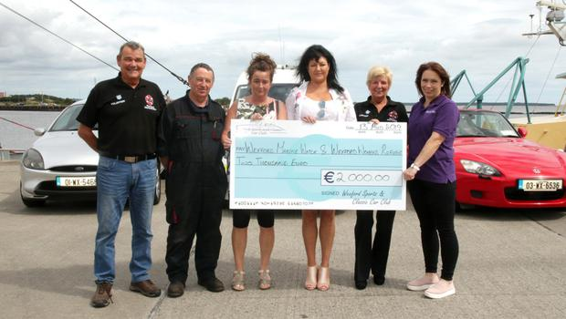 Wexford Sports and Classic Car Club present the €2,000 proceeds of their annual show to Wexford MarineWatch and Wexford Womens Refuge. From left: Bob Tracy, Junior Hayes. Angela Hore, Margo Doyle, Marian Tracy and Leanne Carroll