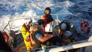 The injured skipper is taken on board the lifeboat