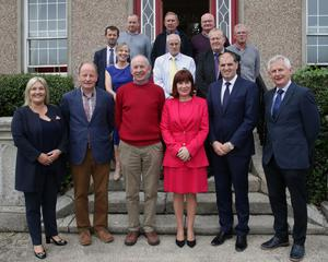 Back: Sean Foley, Mairead Coleman, Alan Gabbett, Alan Vaughan, John Murphy, Joe Gabbett, Ger Mackey and Mark Lawlor. Front: Verona Murphy, Pat Quigley (Past Principal), Bernard Doyle, Josepha Madigan TD Minister for Culture,Heritage and the Gaeltacht and Paul Kehoe TD Minister of State with special responsibility for Defence and Robert O'Callaghan (Principal)