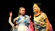 Caitlin Laffan playing the role of Dorothy with Faye Jordon as the Scarecrow