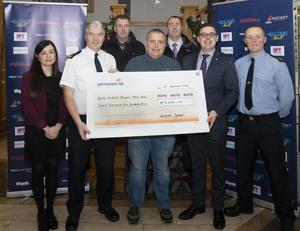 At the cheque presentation. From left: Rebecca McMcGuire (Talbot Hotel), Chief Superintendent Paddy McMenamin, Superintendent Jim Doyle, Eamonn Mernagh (County Wexford Hospital Homecare), Detective Garda Colm Dunne, Robert Miller (Talbot Hotel) and Garda Niall Brophy
