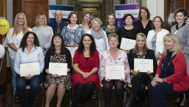 At the presentation of Certificates in Attachment, Child Development and Interventions for Foster Carers in Carlow IT Wexford Campus were (back, from left): Amanda Bradley, Veronica Nolan, Vincent Daly, Rosemary Fitzpatrick, Bessy Mendri, Sheelagh Collier (tutor), Aly McNeill, Maria Connor, Karen McLoane (tutor), Pauline O'Sullivan (tutor) and Susan Barnes (tutor); (seated, from left): Geraldine Molloy, Teresa Doyle, Anne Marie Stafford (tutor), Sandra Kirwan, Lisa Clancy and Dr Jeanette Davies (Deputy Head of Campus).
