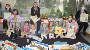 Veronica Murphy, Ciara Walsh and Roza Polrolnik with kids from Jungle Box Child Care were in Wexford Library as part of the new reading initiative. They were pictured with Cllr Ger Carthy, chairman of Wexford County Council and Mary Savage (librarian). The kids received a Little Library Pack to take home