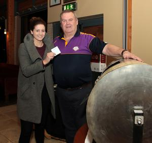 Mags D'Arcy draws the winning ticket, assisted by Peadar Dempsey