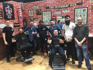 Noel McHugh (fourth from left) and the Cutthroat Barbers' team cutting the hair at the RDS Motorbike and Scooter Show.