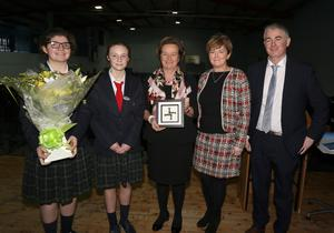 A presentation to Ambassador Jones on a recent visit to her old school, Coláiste Bríde, in Enniscorthy. Pictured: students Sarah O'Dowd and Julia Dziadek, Barbara Jones, Principal Kiera O'Sullivan and Deputy Principal Neil Moynahan