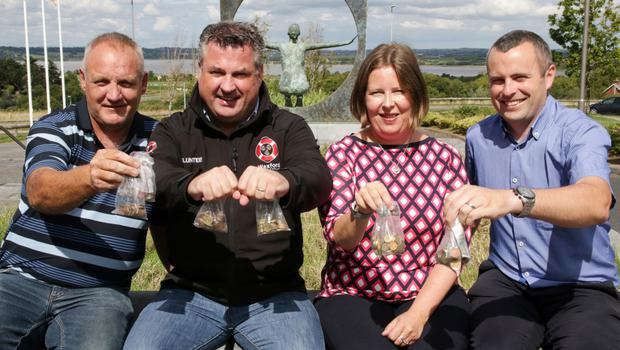 Show me the money: Colm Hearne of Hearne Construction, Cllr. George Lawlor and Sonia Hunt and Michael Brazzil of Wexford County Council with the coins.