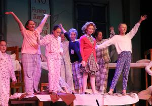 Sophie Barron (Annie) and the orphans on stage.