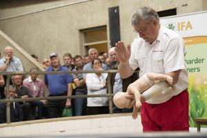 Paddy Redmond, Red Cross, gives a demonstration on how to save a baby from choking