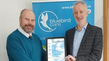 Michael Corcoran receives the EcomMeritc Certification from Phil Walker