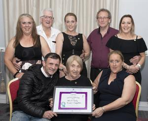 A certificate of appreciation being presented to the Walsh family for organising the event: (Back, from left) Anne Walsh, Tim Walsh, Tracey Walsh, John Dunne, Audrey Walsh, (front) Danny McNulty from Temple Street Hospital, Kathleen Walsh and Helen Walsh