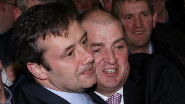 Thank God it's over: Michael D'Arcy and Paul Kehoe embrace at the count  centre in Wexford yesterday (Monday) evening at the end of the recheck of votes.
