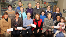 At the presentation of cheques from the Leo Carthy Memorial Weekend in Our Lady's Island community centre, from left, back – Louise Morris (committee), Nicky White, Our Lady's Island GAA, Rosaleen Keegan (committee), John Hayes, St. Pauls Athletic Club, Cllr. Ger Carthy (committee), Michael Carthy, Sarah Hyland, and Wendy Moran, Paiste Beag; front – Jean Carr, Scoil Mhuire Broadway Parents Association, Margo Moran, Our Lady's Island community centre, Brian Breslin, (chairman), Bridget Sinnott, Irish Heart Foundation, Assumpta Carthy (committee ), Trisha Boyce, Ballycogley Players and Erin Carthy