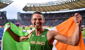 Thomas Barr celebrating his bronze medal win