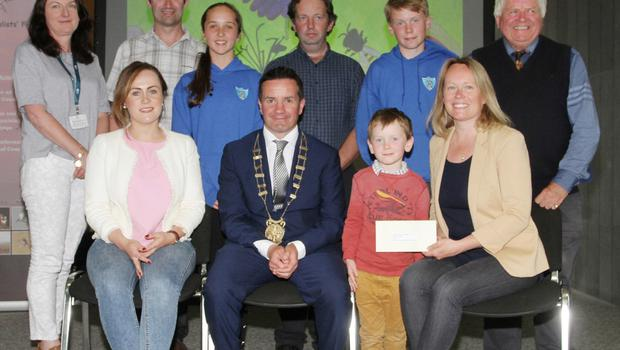 Snap Into Action Winners, back row: Cliona Connolly, Wexford County Council; Declan Cosgrove, Duncormick Harvest Festival; Isabelle Walsh, Scoil Mochua; Nicholas Egan, Wexford Naturalists Field Club; Cathal Murphy, Scoil Mochua and Don Conroy, artist.Front: Grainne Waters, Scoil Mochua; Cllr John Hegarty, Austin Murphy and Clara Murphy, Duncormick Harvest Festival.