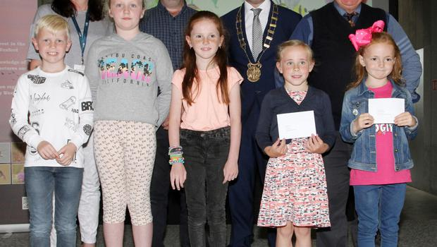 1st and 2nd class winners, back row: Cliona Connolly, Wexford County Council; Nicholas Egan, Wexford Naturalists Field Club; Cllr John Hegarty, and Don Conroy artist and judge; Front row: Billy Plummer, Scoil Naomh Maodhóh Ferns; Róisín Reville, Carroreigh NS; Kiera O'Connor, Naomh Maodhóg Ferns; Clodagh Byrne, Ballaghkeene NS and Ellie Briget Balfe, St Senan's Primary School.