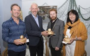 Richard Hayes, vice-president, Strategy, at Waterford Institute of Technology, presents the writing competition winners with their prizes. From left: Stephen Wade, Fiction winner, Richard Hayes, Daniel Wade, Poetry winner and overall winner, and Rosemary Tumelty, Memoir winner