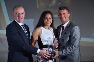 Rianna receiving her award from Tom Dennigan, left, of Continental Tyres and Republic of Ireland manager Colin Bell