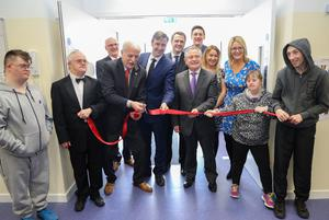Minister of State with special responsibility for Disability Issues, Finian McGrath, cuts the ribbon. Also pictured: Dean Goodison, Jimmy Kelly, Gerry Heeney,Minister Michael D'Arcy, James Browne TD, Brendan Howlin TD, Thomas O'Leary, Lynsey Moorehouse, Geraldine Roche, Lesley O'Leary and Paul Houlihan