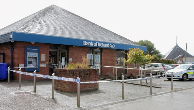 Gardai at the scene of the attempted bank robbery at Bank of Ireland Rosslare Harbour last August.