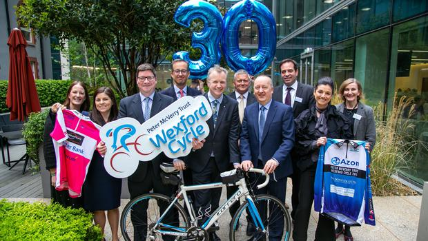 Broadcaster, Matt Cooper and CEO of Peter McVerry Trust, Pat Doyle with supporters, at the launch of the 30th anniversary Wexford Cycle at Arthur Cox, Dublin
