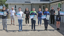 (Front, from left) Ballyhogue NS sixth class pupils Jack Redmond, Kian Dagg, Chelsea Doyle, Cian Fortune and Anthony Byrne with (back) principal James Roberts, teachers Michelle Furlong and Marria Sugrue and Fr Billy Caulfield at their graduation
