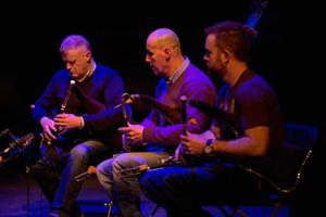 The trio performing in the Abbey Theatre