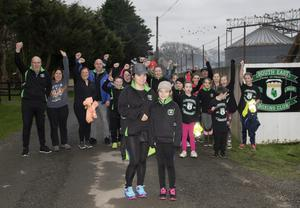 Aoife Purcell and her mum Jean O'Brien from the South East Boxing Club in Bridgetown, pictured with supporters as they set out on their walk to Kilkenny Castle to raise funds for the club