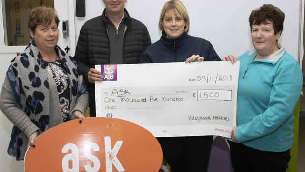 The presentation to Ask: Sandra Walsh, Scott Mernagh, Sharon Pettit of Ask, and Rose Day