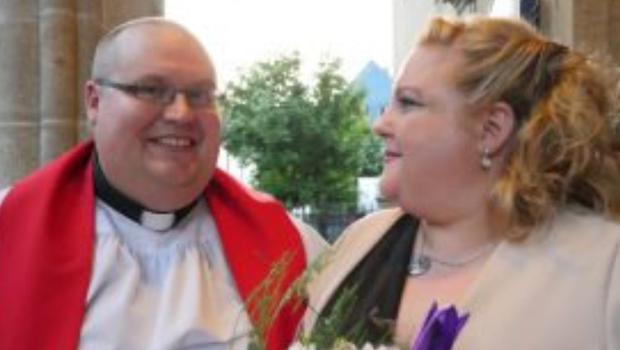 Reverend Conor O'Reilly and his wife Mollie outside St. Iberius Church