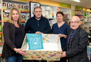Launching the Baby Box in Fehily's (from left): Emma Hyland, Derek Fehily, Ali Byrne, SCBN, and Cllr Davy Hynes