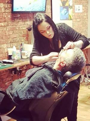 Carina McLoughlin of McLoughlin's Traditional Barbers in action