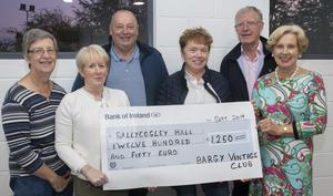 Bargy Vintage Club present a cheque for €1,250 to Ballycogley Hall. From left: Anne Mullins, Eileen Hayes, Paddy Hayes, Mary Fenlon, John Rowe and Eleanor Quilty