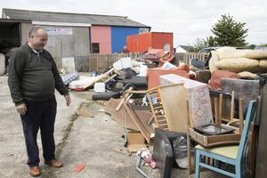 Bart Murphy with some of the rubbish he needs to get rid of from his Traceystown premises.