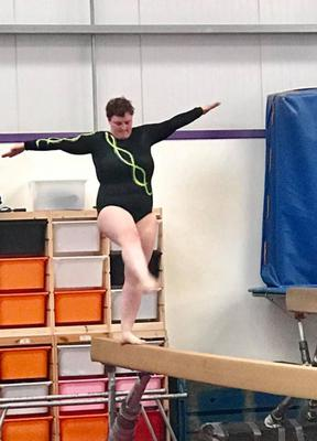 Lisa demonstrates her prowess on the beam.