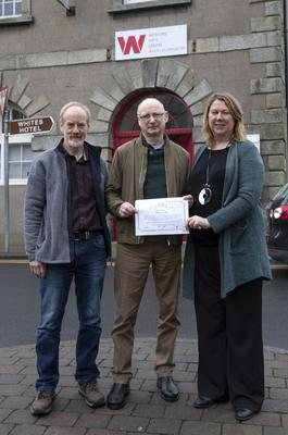 The playwright Billy Roche with artist Tony Robinson and Elizabeth Whyte of Wexford Arts Centre