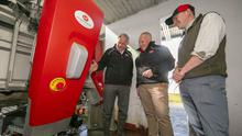 At the Lely Center Enniscorthy Robotic milking open day on Gerald and Henry Dunne's farm in Bree were Tom O'Leary, centre, (General Manager of Lely Center Enniscorthy) with Gerald and Henry Dunne