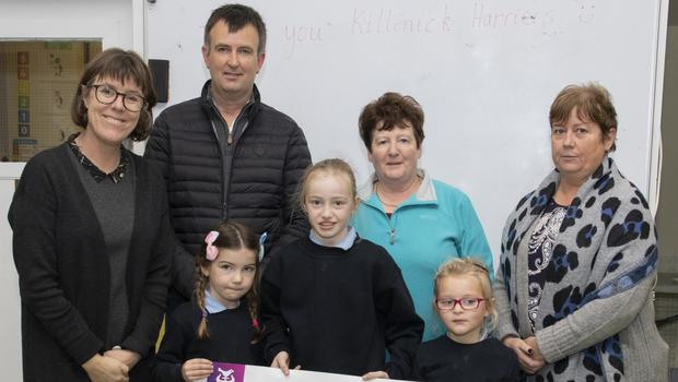 The presentation to Mayglass NS: Bernie Leahy, principal, with Scott Mernagh, Rose Day and Sandra Walsh, of the Killinick Harriers, and (front) Lucy Day, Grace Day and Aoife Robinson