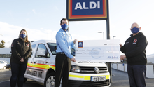 Kathrina Doyle and Jim Delaney of Wexford Marine Watch receive a €500 donation from Aldi Wexford Charity Champion Luke Walshe as part of Aldi's Community Grants programme