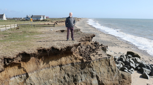 Cllr Jim Moore at one of the gullies formed by the erosion at Seaview