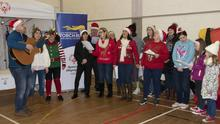 Members of the Oyster Lane Theatre Group singing carols.