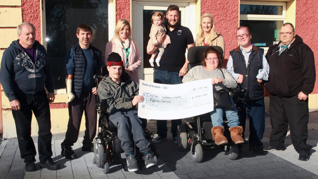 At the presentation of €1,000 to the Irish Wheelchair Association at Porter's Bar, from left (front), Eoin Murphy and Sarah Louise Fortune; (back), Sean Furlong IWA, Stephen Furlong, Service Support Officer, Selina Power, proprietors, Simon andOrla Besanson with their daughter, Grace, John Sugrue and Ger Jordan