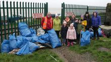 Members and helpers of Wexford Estuary Clean Coast Group with bags of rubbish picked up in the Maudlintown area