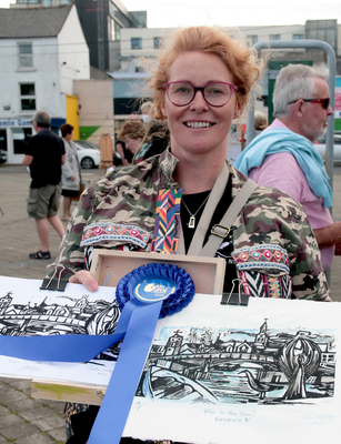 Painting in this years Art in The Open on Sunday was runner up prizewinner Trisha O'Callaghan from Kilmore who won a blue rosette with her Lino painting of Wexford from Ferrybank